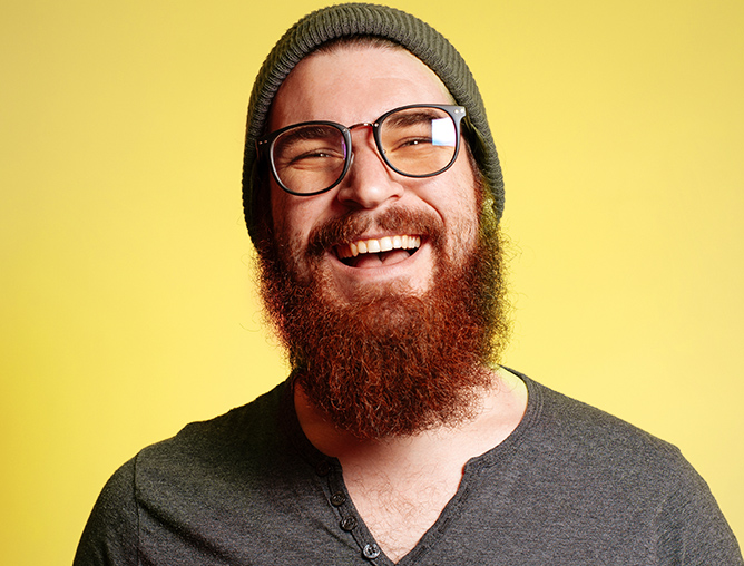 Smiling man in glasses with beard