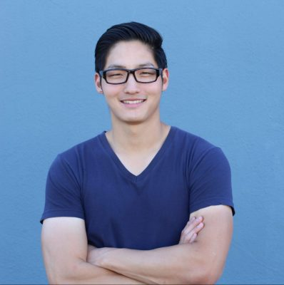 Portrait of a handsome Asian man with glasses crossing his arms; Shutterstock ID 570808393; Purchase Order: comps; Job: ; Client/Licensee: ; Other: